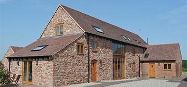 Farmyard barn converted into new house